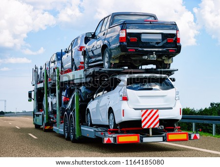 Cars carrier at the road of Poland. Truck transporter #1164185080
