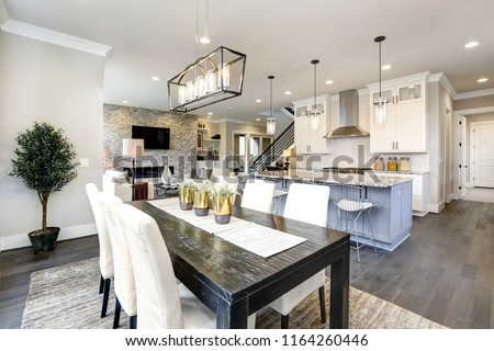 Beautiful kitchen in luxury modern contemporary home interior with island and chairs Royalty-Free Stock Photo #1164260446