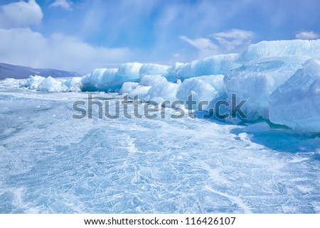 outdoor view of ice blocks at frozen baikal lake in winter Royalty-Free Stock Photo #116426107