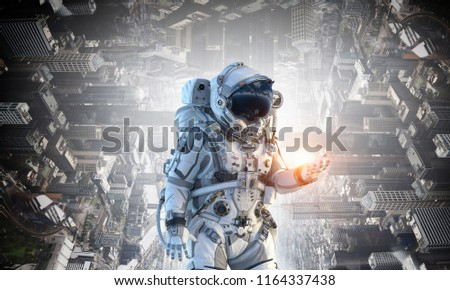 Spaceman and his mission. Mixed media #1164337438