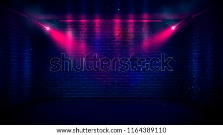 Background of an empty corridor with brick walls and neon light. Brick walls, neon rays and glow #1164389110