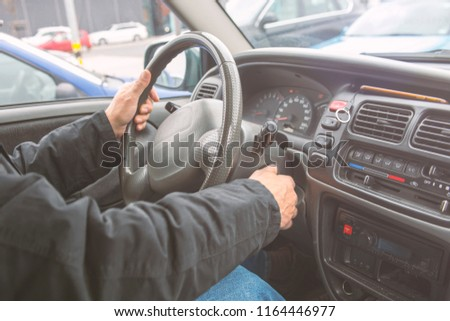 Man driving car. Hands on steering wheel #1164446977