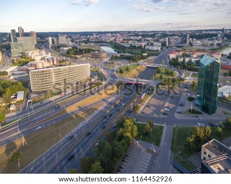 VILNIUS,LITHUANIA - AUGUST 13, 2018: Vilnius Business District with Traffic and Circle in Background #1164452926