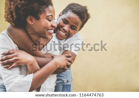 Happy young mother having fun with her child - Son hugging his mum outdoor - Family lifestyle, motherhood, love and tender moments concept - Focus on kid face #1164474763