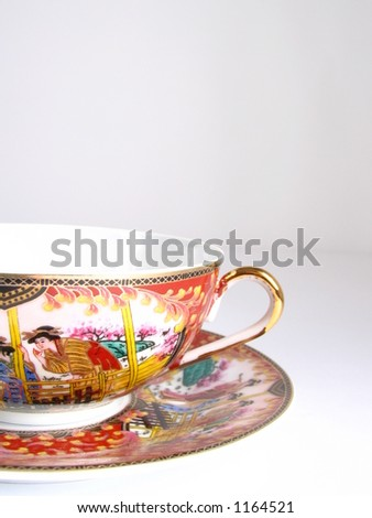 teacup covered with drawings #1164521