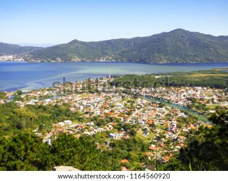 A view of Lagoa da Conceicao and Barra da Lagoa village from Boa vista hiking path - Florianopolis, Brazil #1164560920