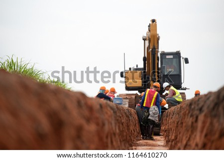 Group of worker and construction engineer wear safety uniform excavation water drainage at construction site #1164610270