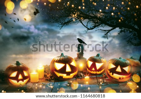 Spooky halloween pumpkins on wooden planks with dark horror background. Celebration theme, copyspace for text. #1164680818
