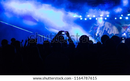 silhouettes of crowd at concert near stage #1164787615