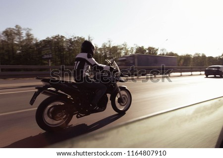 motorcyclist with classic motorbike #1164807910