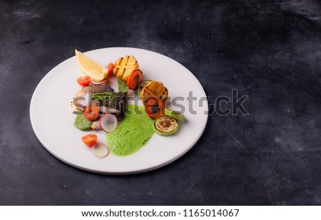 Seabass fillet with vegetables and molecular foam #1165014067
