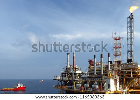 Offshore construction platform for production oil and gas, Oil and gas industry and hard work,Production platform and operation process by manual and auto function, oil and rig industry an #1165060363