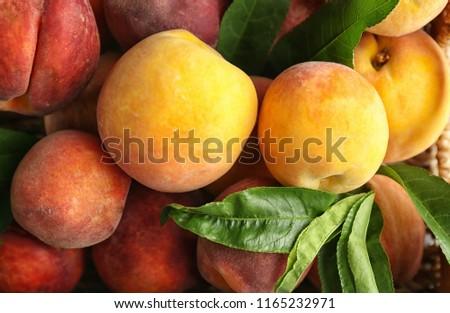 Fresh peaches in basket, closeup #1165232971
