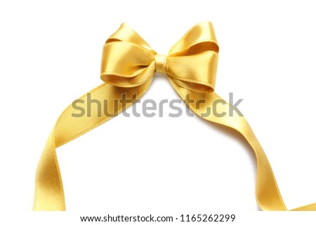 Bow from golden satin ribbon on white background #1165262299