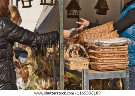 pre-Christmas shopping of wicker baskets,  trade in  Easter baskets in Kazimierz Dolny #1165306189