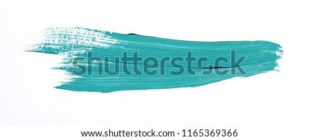 Turquoise brush stroke isolated over white background Royalty-Free Stock Photo #1165369366