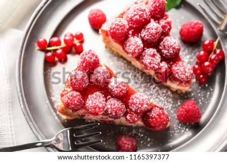 Pieces of delicious raspberry cheesecake on plate, closeup #1165397377