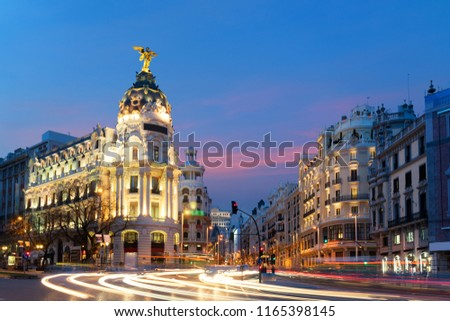 Car and traffic lights on Gran via street, main shopping street in Madrid at night. Spain, Europe. Landscape and culture travel, or historical building and sightseeing concept #1165398145