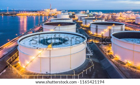 Aerial view oil terminal is industrial facility for storage of oil and petrochemical products ready for transport to further storage facilities. #1165421194