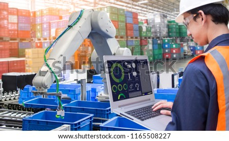 Industry 4.0 Robot concept .Engineers use laptop computers for machine maintenance, automation tools, robot arm at the factory. #1165508227
