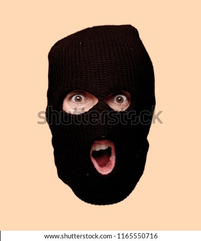 young crazy bearded man cutout head expression isolated. criminal with ski mask role. angry expression #1165550716