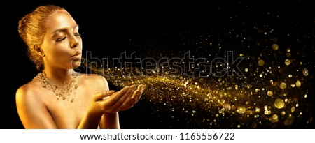 Gold Makeup - Fashion Model Blowing Golden Dust #1165556722