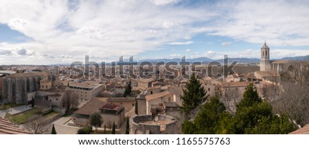 View of the landscape and the bell tower of the Cathedral of Girona from the fortress wall, Spain #1165575763