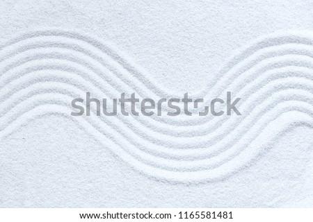 Zen pattern in white sand #1165581481