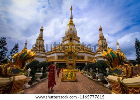 The monks walk to Wat Maha Chedi Chai Mongkol. Roi Et Tourist Attractions #1165777615