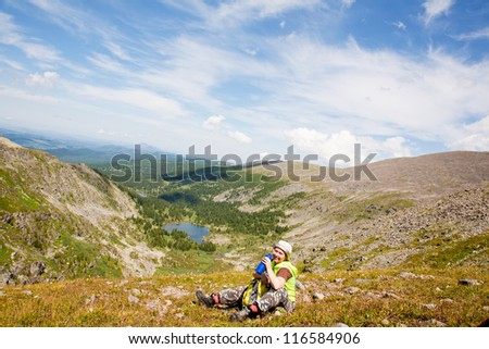 mountains tourist drinking water from bottle at mountain peak #116584906