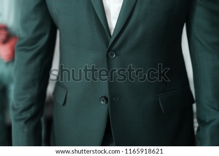 Close up of a mans waistcoat with one button untied. #1165918621