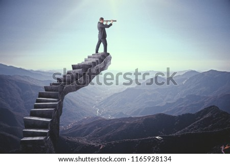 Businessman looking into the distance on abstract stairs. Landscape background. Research and vision concept  Royalty-Free Stock Photo #1165928134