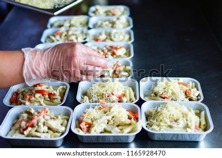 prepared diet Lunches in lunch boxes: chicken salad, parmesan, pasta and cherry tomatoes with Basil, the concept of take-away and food delivery #1165928470