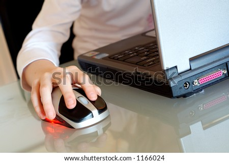 a girl using a laptop computer on a highly polished glass desk #1166024