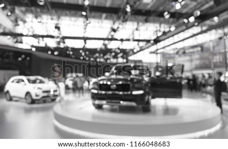 Abstract blurred photo of motor show, car show room #1166048683