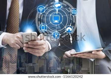 Young business people using mobile phone with modern city buildings background. Future telecommunication technology and internet of things ( IOT ) concept. #1166120242