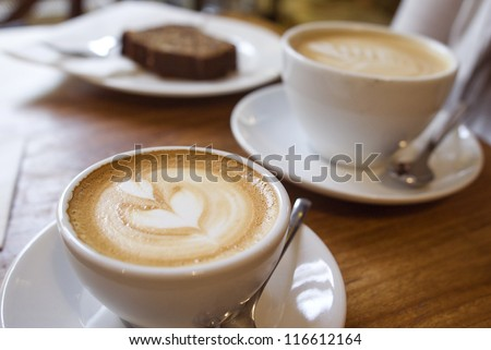 Two cups of coffee on the table, latte art Royalty-Free Stock Photo #116612164