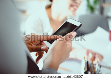 Cropped shot of businesswoman using smartphone with blank screen #1166143807