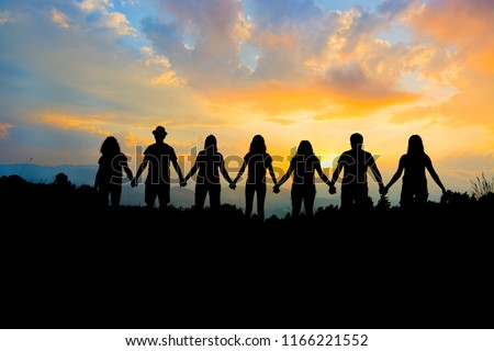 Group of people holding hands team unity Royalty-Free Stock Photo #1166221552