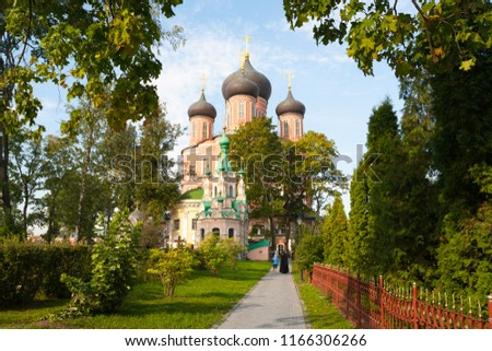 MOSCOW, RUSSIA - AUGUST 28, 2018: Mother of God Cathedral, Ivan Lestvichnik Cathedral and trees at Donskoy Monastery in Donskaya Street. This monastery was founded in 1591. #1166306266