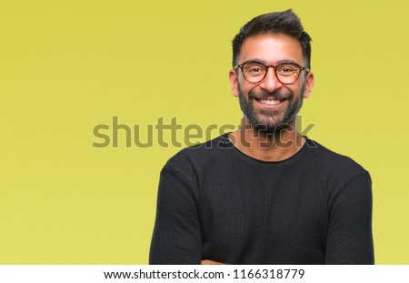 Adult hispanic man wearing glasses over isolated background happy face smiling with crossed arms looking at the camera. Positive person. #1166318779