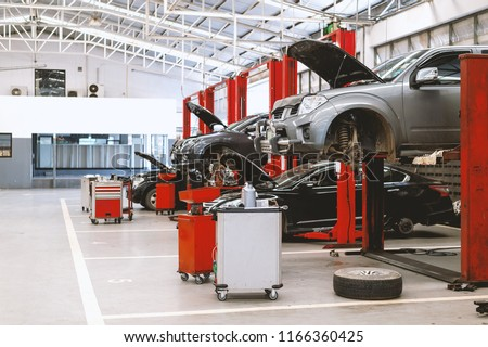 car repair station with soft-focus and over light in the background Royalty-Free Stock Photo #1166360425
