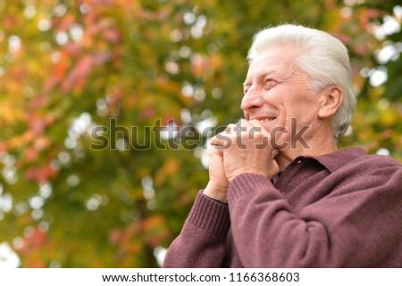Close up portrait of senior man posing #1166368603