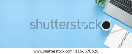 Minimal work space - Creative flat lay photo of workspace desk. Top view office desk with laptop, notebooks and coffee cup on blue color background. Panoramic banner background with copy space. #1166370628