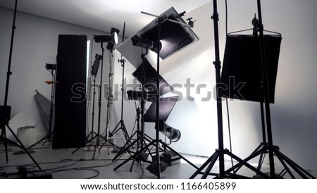 Lighting setup in studio for commercial works such as photo movie or video film production which use many LED light more than 1000 watts with big softbox snoot reflector umbrella and tripods.