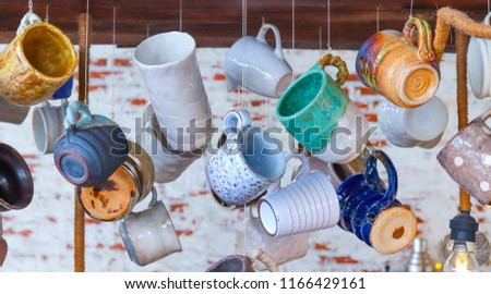 colorful ceramic glass mug in different shape and form  #1166429161