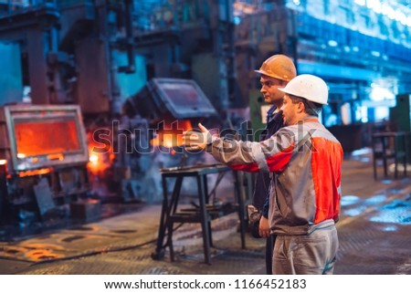 Workers in the steel mill. #1166452183