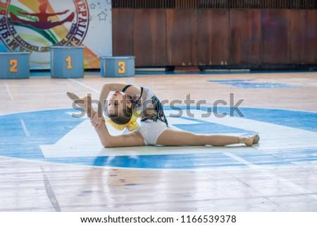 "Kamenskoye, Ukraine - February 18, 2018: Championship KPSK ""Prometheus"" oncheerleading, young cheerleaders perform at the city cheerleading championship #1166539378"