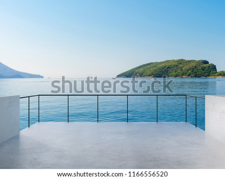 Balcony View Of Sea And Mountains Landscape During Sunny Day Royalty-Free Stock Photo #1166556520