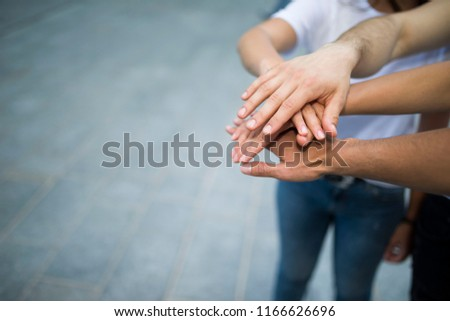 Friends putting their hands together #1166626696